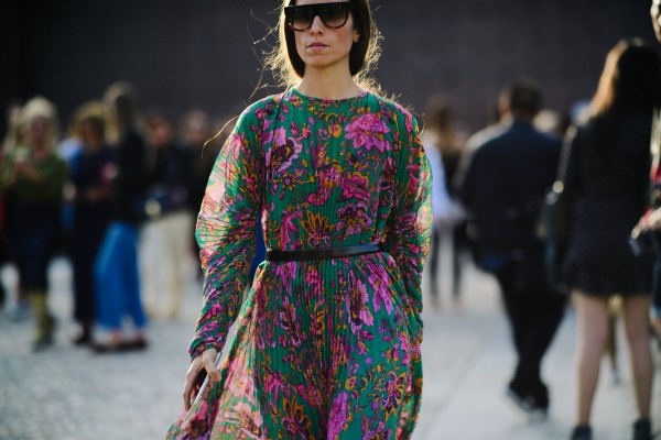 Woman in sunglasses and floral dress